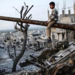 scontri a fuoco e macerie in Siria
